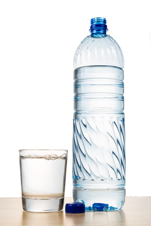 water bottle: Refreshing natural mineral water in plastic bottle with transparent glass in white background