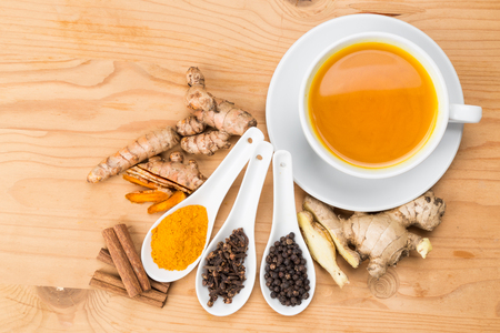 Aromatic turmeric tea with black pepper, cinnamon, cloves and ginger offers many wellness health benefits Stock fotó - 51692184