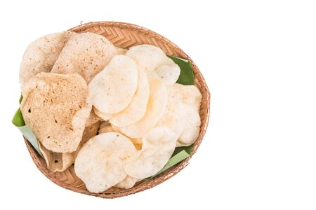 keropok: Freshy fried delicious prawn and fish crackers snack served on rattan tray with white background