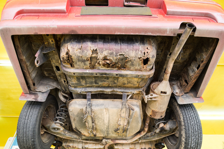 catalytic: Car with rusty, damaged, corroded undercarriage at workshop for repair work Stock Photo