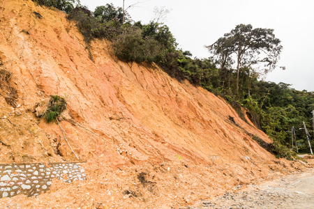 damage control: Slope erosion with earth collapse at slope in tropical climate environment after heavy rain fall