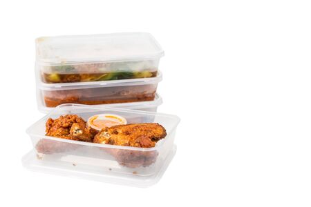 lunch meal: Convenient but unhealthy disposable plastic lunch boxes with take away meal on white background