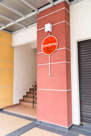 panic button: Emergency panic button with strobe at building for security alert
