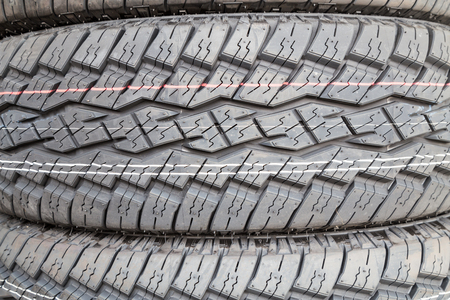 traction: Closeup of new tire threads with deep groves for grip and traction