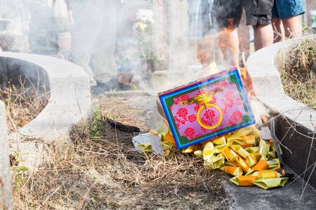 ancestors: KUALA LUMPUR, MALAYSIA, April 2, 2016: Chinese descendants burnt offerings to ancestors during the annual QingMing festival, or tomb sweeping day at cemetery in Malaysia