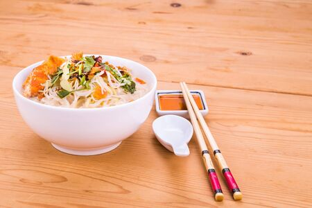vermicelli: Rice vermicelli with fried fish head noodle soup, a popular delicacy in Malaysia Stock Photo