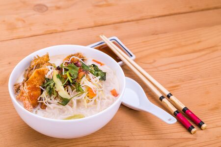 asian noodle: Rice vermicelli with fried fish head noodle soup, a popular delicacy in Malaysia Stock Photo