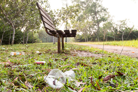 degradable: Lots of litter of non degradable rubbish at public park poses a threat to ecology Stock Photo