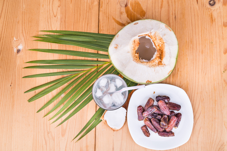 break fast: Top view of coconut juice and sweet dates are simple and common iftar break fast food for muslim during Ramadan fasting month