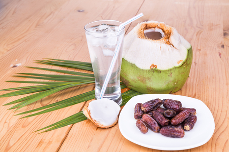 break fast: Coconut juice and sweet dates are simple and common iftar break fast food for muslim during fasting month of Ramadan