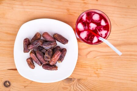 break fast: Sweet syrup and sweet dates are simple and common iftar break fast food for muslem during fasting month of Ramadan