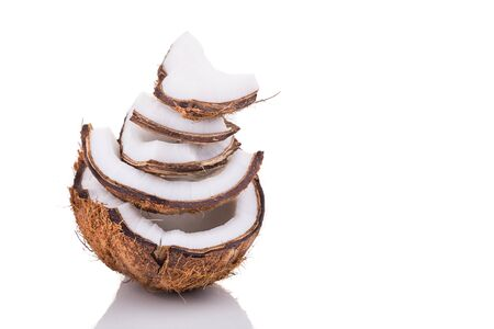 copra: Old brown organic coconut fruit copra broken into pieces and stacked on white background Stock Photo
