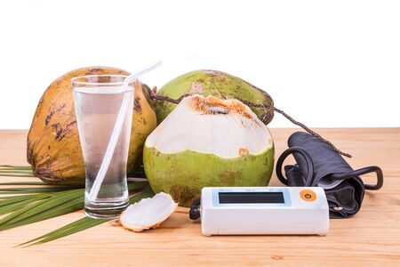 reduce risk: Fresh coconut juice helps to lower blood pressure, hypertension, blood cholesterol and reduce risk of heart attack Stock Photo