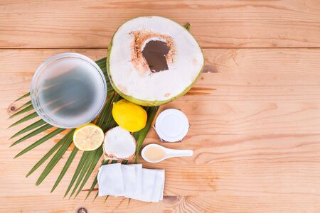 moisturize: Overhead view of natural face mask made of coconut juice, lemon juice, and honey to clean and moisturize dry skin