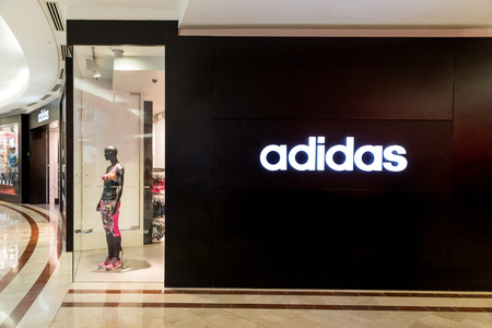 adidas: KUALA LUMPUR, MALAYSIA, May 20, 2016: Adidas signage on its outlet at KLCC, Kuala Lumpur.  Adidas was founded in 1948 in Germany, is one of the leading global sportswear manufacturer. Editorial