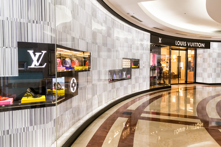 vuitton: KUALA LUMPUR, MALAYSIA, May 20, 2016: A Louis Vuitton LV outlet in KLCC, Kuala Lumpur., with selective focus on the LV signage.  The Louis Vuitton company operates with more than 460 stores worldwide.