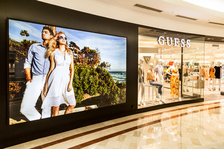 guess: KUALA LUMPUR, MALAYSIA, May 20, 2016: Guess outlet at KLCC Shopping Mall, Kuala Lumpur.  Guess is an American upscale clothing line brand popular with its brand of jeans.