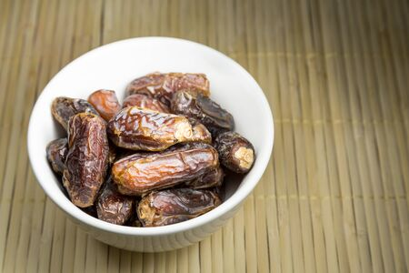 break fast: Bowl of sweet dates, common break fast food among Muslim during iftar within the month of Ramadan Stock Photo