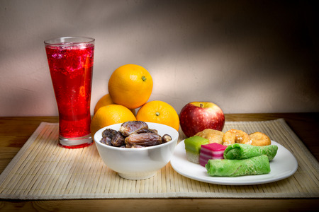food and drink: Cold refreshing syrup drinks, sweet dates, kuih are simple and common iftar break fast food during fasting month of Ramadan