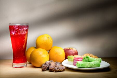 break fast: Cold refreshing syrup drinks, sweet dates, kuih are simple and common iftar break fast food during fasting month of Ramadan