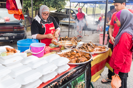 break fast: KUALA LUMPUR, MALAYSIA, June 7, 2016:  FIrst day of Ramadan with food vendors at street bazaar selling delicacies catered for iftar or buka puasa.