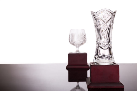 foreground focus: Two elegant crystal trophies with focus on vase trophy at foreground Stock Photo