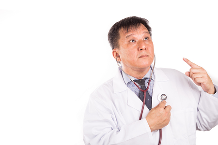 listening to heartbeat: Matured and funny Asian medical doctor listening to own heartbeat using stethoscope