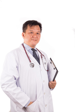 matured: Matured, confident Asian male medical doctor with stetescope and in white coat, isolated in white background Stock Photo
