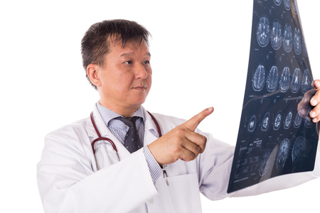 matured: Matured and confident Asian neurology medical doctor examining head MRI images on white background Stock Photo