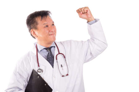 rejoicing: Successful matured Asian medical doctor rejoicing with raised hand on white background