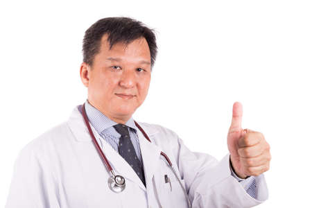matured: Matured, confident Asian male medical doctor with stethoscope and in white coat displays thumb up