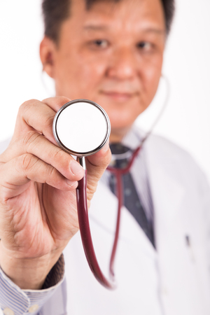 matured: Selective focus on stethoscope held by matured and confident Asian male medical doctor
