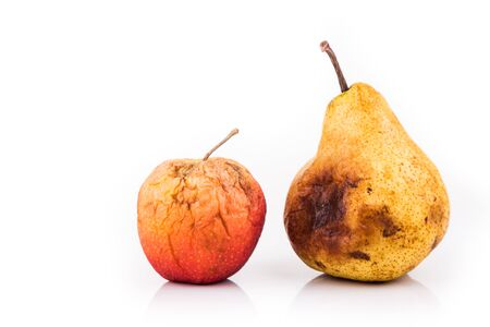decomposing: Rotten and decomposing organic red apple and pear on white background