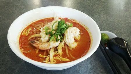 laksa: Bowl of spicy Sarawak Laksa, popular noodle delicacy in Malaysia Stock Photo
