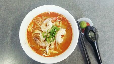 vermicelli: Bowl of spicy Sarawak Laksa, popular noodle delicacy in Malaysia Stock Photo