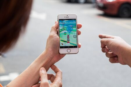 developed: KUALA LUMPUR, MALAYSIA, JULY 16, 2016: An IOS user plays Pokemon Go, a free-to-play augmented reality mobile game developed by Niantic for iOS and Android devices.