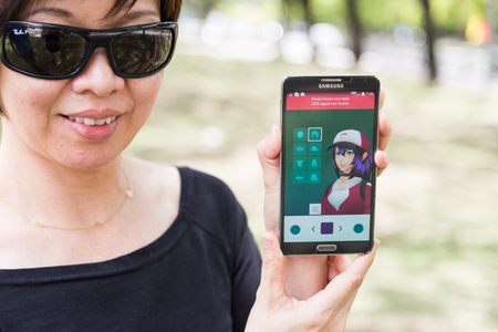 developed: KUALA LUMPUR, MALAYSIA, JULY 24, 2016: An Android user plays Pokemon Go, a free-to-play augmented reality mobile game developed by Niantic for iOS and Android devices. Editorial