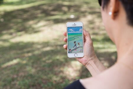 developed: KUALA LUMPUR, MALAYSIA, JULY 24, 2016: An IOS user plays Pokemon Go, a free-to-play augmented reality mobile game developed by Niantic for iOS and Android devices.