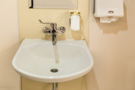sanitizer: Washbasin with soap hand sanitizer and tissue paper in hospital