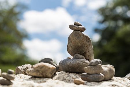 Closeup of Zen rock arrangement with nature sky background Stock Photo