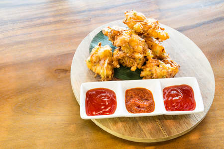 onion bhaji: Cucur bawang or onion fritters with dips, popular Malaysia food
