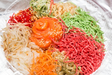 Yee Sang or Yusheng with raw salmon fillet, traditional Chinese New Year prosperity delicacies in Malaysia and Singapore Фото со стока