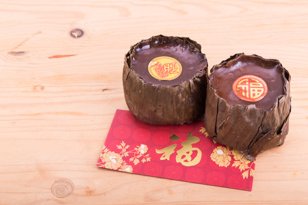 Nian Gao or glutinous rice cake with Good Luck in Chinese words 版權商用圖片 - 65818529