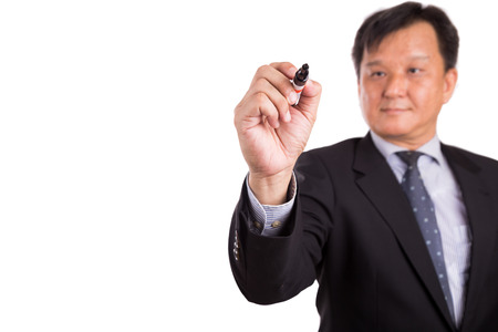 hombre escribiendo: Asian business man in suit writing with marker pen on white background