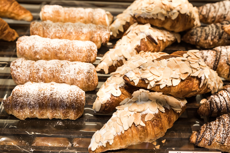 pastry crust: Tray of freshly baked gluten free croissant with toping Stock Photo