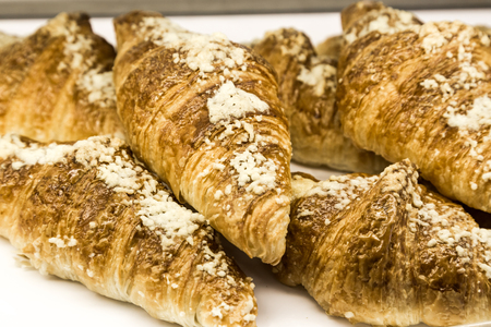 pastry crust: Tray of freshly baked gluten free croissant with eggs toping Stock Photo