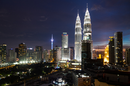KUALA LUMPUR, MALAYSIA - JULY 23, 2016: View of the Petronas Twin Towers at KLCC City Center and KL Tower during dusk hour. The most popular tourist destination in Malaysian capital