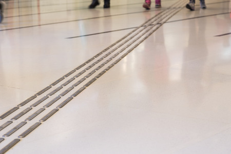 foot path: Indoor tactile paving foot path for the blind and vision impaired handicap in Hong Kong
