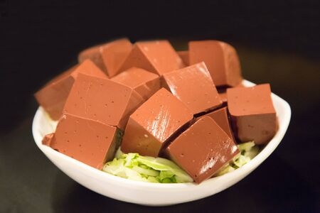 manjar: Plate of hardened pig blood in cubes, food delicacy among Chinese