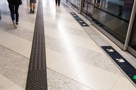 foot path: Tactile paving foot path for the blind and vision impaired handicap at subway station in Hong Kong